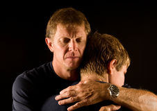 father-son-emotional-hug-12317332