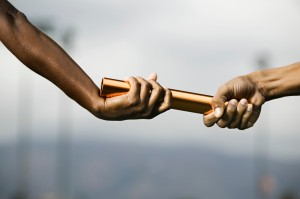 Hands Passing Baton --- Image by © Royalty-Free/Corbis